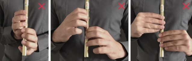 Holding the tin whistle incorrectly